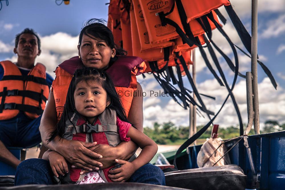 Guajarà-Mirim, Brazil. Marcela is taking her daughter Silvia back home from school. She studies in the bilingual school of Guajarà-Mirim on the Brazilian side.