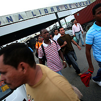 Workers exit from the Free Trade Zone in Colon, at the Atlantic gateway to the Panama Canal, in Panama on Friday, September 7, 2007. (Photo/Scott Dalton).