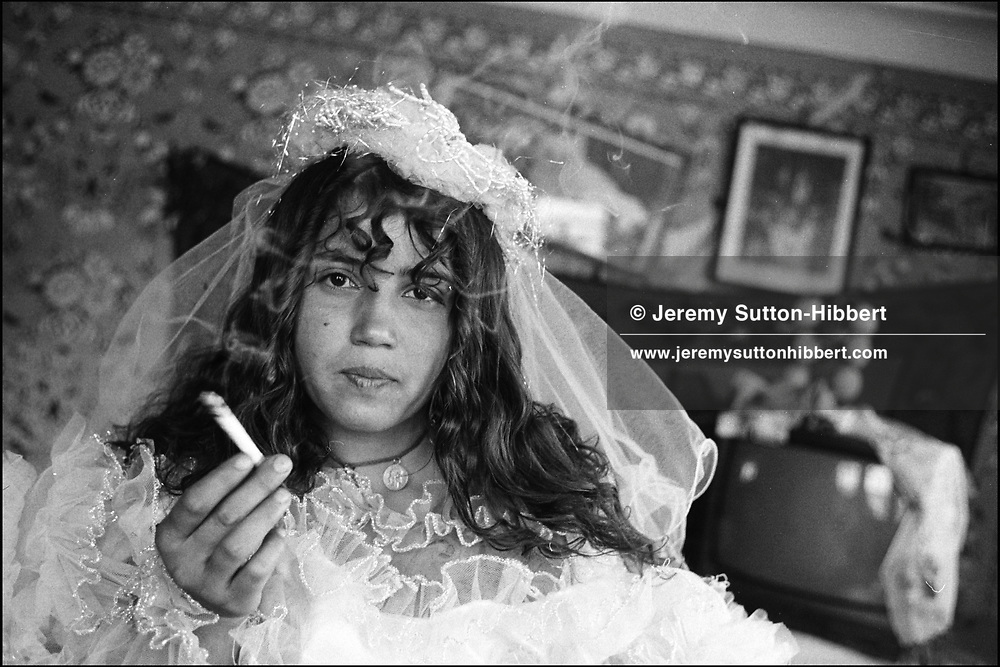 """SOFIA MIHAI, AGED 12, """"MARRIED"""" TWICE, AND RETURNED HOME TO LIVE WITH HER PARENTS TWICE. SINTESTI, ROMANIA. MAY 1997..©JEREMY SUTTON-HIBBERT 2000..TEL./FAX. +44-141-649-2912..TEL. +44-7831-138817."""