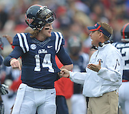 Mississippi quarterback Bo Wallace (14) talks with Mississippi Coach Hugh Freeze against Troy at Vaught-Hemingway Stadium in Oxford, Miss. on Saturday, November 16, 2013. (AP Photo/Oxford Eagle, Bruce Newman)