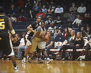 """Ole Miss guard Nick Williams (20) makes a steal at C.M. """"Tad"""" Smith Coliseum in Oxford, Miss. on Saturday, December 4, 2010."""