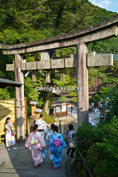 Tourists and pilgrims exploring the Kiyomizu-dera Temple.