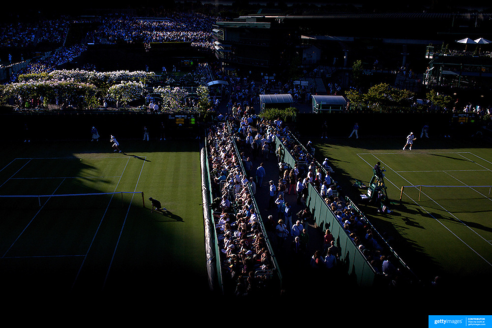 The late afternoon light decends on the outside courts during the first round matches at the All England Lawn Tennis Championships at Wimbledon, London, England on Tuesday, June 23, 2009. Photo Tim Clayton.