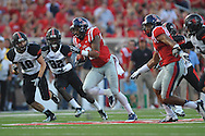 Mississippi wide receiver Donte Moncrief (12) scores on a 67 yard pass play as Southeast Missouri State's Colby Baker (18) and Southeast Missouri State's Reggie Jennings (32) chase at Vaught-Hemingway Stadium in Oxford, Miss. on Saturday, September 7, 2013. (AP Photo/Oxford Eagle, Bruce Newman)