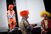 """Cole Bros. clowns prepare for a show during a stop in Frederick Maryland. The Cole Bros. Circus of the Stars is celebrating its 127th season and bills itself as the """"World's Largest Circus Under The Big Top."""""""