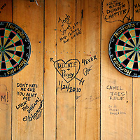 ST. PETE BEACH, FL -- February 13, 2010 -- Messages are strewn about the outdoor dartboards at the Postcard Inn in St. Pete Beach, Fla., on Saturday, February 13, 2010.  The beachfront U-shaped hotel, originally built in 1957, was renovated into a throwback surf shack of sorts with rooms featuring surfing imagery and vintage furniture. (Chip Litherland for The New York Times)
