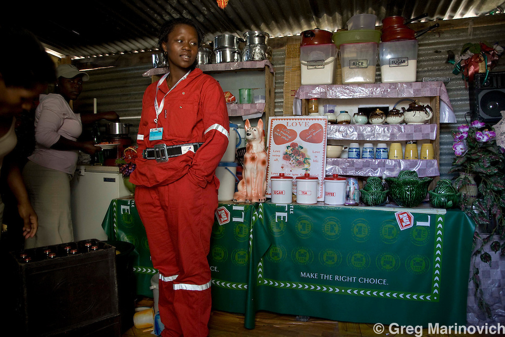 Nozuko Ogthile works underground as a iner at Anglo Platinum. She is from Lusikisiki in the Eastern Cape province of South Africa lives with her 4 sisters in a shack that doubles as a shebeen in in the shanty town of Zakhele, at Phokeng April 30, 2008. Tens of thousands of non Bafokeng nation people from all over southern Africa have come to the mines near Rustenburg to seek their fortune from the platinum boom. Many are disappointed and live in squalor. Photo Greg Marinovich