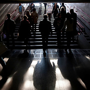Pedestrians climb and descend steps at an underground passageway in downtown Minsk on Sept. 19, 2009.