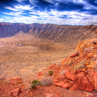 Some HDR spice to an amazing place - Meteor crater, Arizona. A meteorite traveling in excess of 26K MPH (42K KPH) smashed into this part of the desert ~50,000 years ago, creating this massive 1-mile (1.6 Km) across/2.4 mile (4.2 Km) circumference and almost 600 ft (182 M) deep crater. Worth taking the exit off of the freeway if your travels take you out this way!