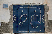 A Tunisian Jewish doorway in the Hara Kebira  neighborhood  in  Djerba on May 25,2016.In Judaism, the fish is a symbol for  fertility and the  Hamsa is  a sign of protection which is used throughout the Middle East and north Africa .<br /> Five years after Tunisia&rsquo;s revolution, and a year after three deadly ISIS attacks, the 1,100 Jews in this tiny island community of Djerba say they do not feel threatened living in Tunisia.(Photo by Heidi Levine).
