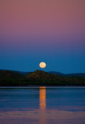 The moon rises over the Prince Regent River on the Kimberley coast creating a staircase to the moon effect.