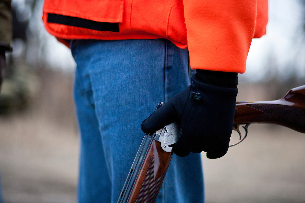 Republican presidential candidate Rick Santorum holds a gun after hunting for pheasants on Monday, December 26, 2011 in Adel, IA.
