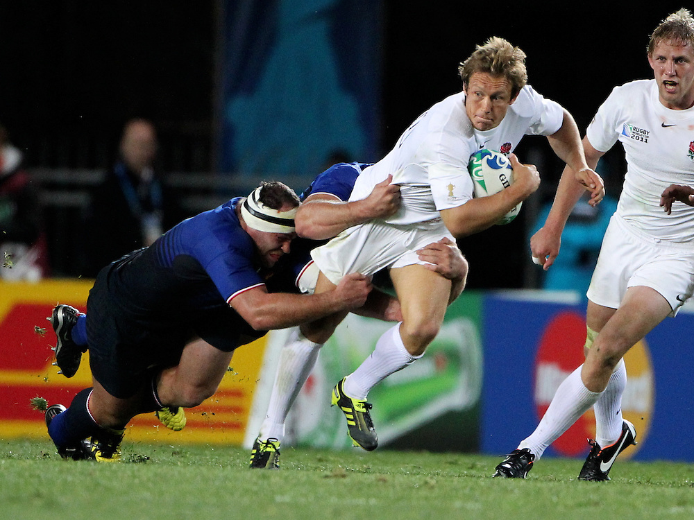 England's Jonny Wilkinson is tackled against France in their Rugby World Cup quarter-final match at Eden Park, Auckland,  New Zealand, Saturday, October 08, 2011. Credit:SNPA / John Cowpland