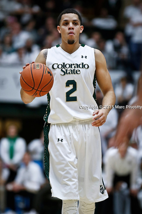 SHOT 1/24/15 9:43:24 PM - Colorado State's Daniel Bejarano #2 dribbles the ball against San Diego State during their regular season Mountain West basketball game at Moby Arena in Fort Collins, Co. Colorado State won the game 79-73. (Photo by Marc Piscotty / © 2015)