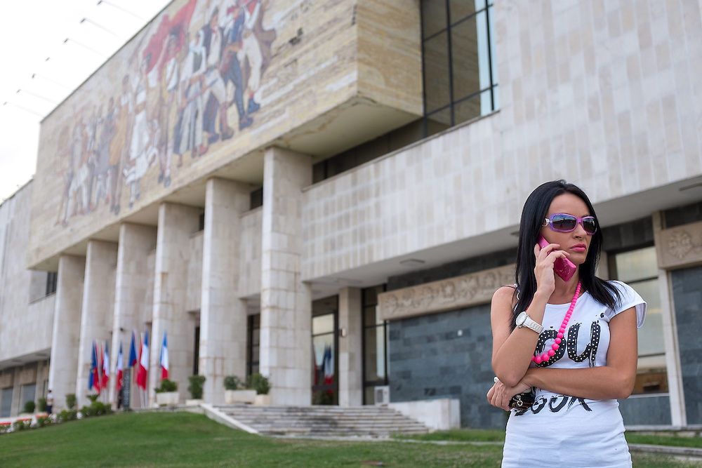 Albania - Albanien - Tirana - Skanderbeg Place - National Museum - National Historical Museum - Woman with Cell Phone ; 14.07.2014; © Christian Jungeblodt
