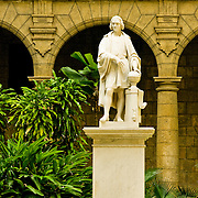 Statue of Christopher Columbus in the courtyard of the Palacio de Los Capitanes Generales, Palace of the Captain Generals in Plaza de Armas, Old Havana, Habana Vieja, Cuba.