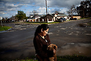 Maria Zapien pets her dog, Shigo, in the Parklawn neighborhood of Modesto, Calif., March 1, 2012.