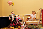 MELISSA LYTTLE       Times<br /> SP_351237_LYTT_TWINS_22 (June 16, 2012, Orlando, Fla.) The Scheinman twins Olivia, left, and Hailey, wait for their talk to begin at the Family Cafe in Orlando, an annual conference for families with children who have special needs. The entire family was invited to present session was titled &quot;Livy's Hope - A Family's Journey of Hope, Inspiration and Love,&quot; and Hailey wrote out her own notes about what she's learned from her sister, that she was nervously going over before the talk.  [MELISSA LYTTLE, Times]