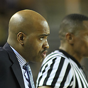 Delaware Men's Head Coach Monté Ross instructs his team from the side lines in the second half of a NCAA regular season Colonial Athletic Association conference game between Delaware and Drexel Sunday, Feb 23, 2014 at The Bob Carpenter Sports Convocation Center in Newark Delaware.