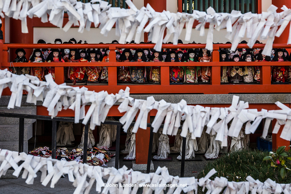 Omikuji at Awashima Shrine - Omikuji or paper wishes, are a method used for divining personal fortunes by drawing straws from a cylinder and then receiving a printed fortune or corresponding to a cypher printed on the stick. This is the type of omikuji found most commonly today at shrines.