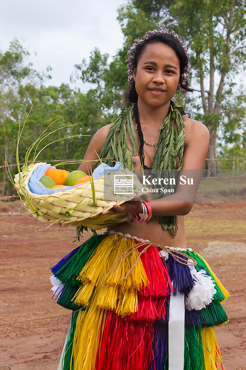 Yapese girl carrying basket of fruit, Yap Island, Federated States of Micronesia