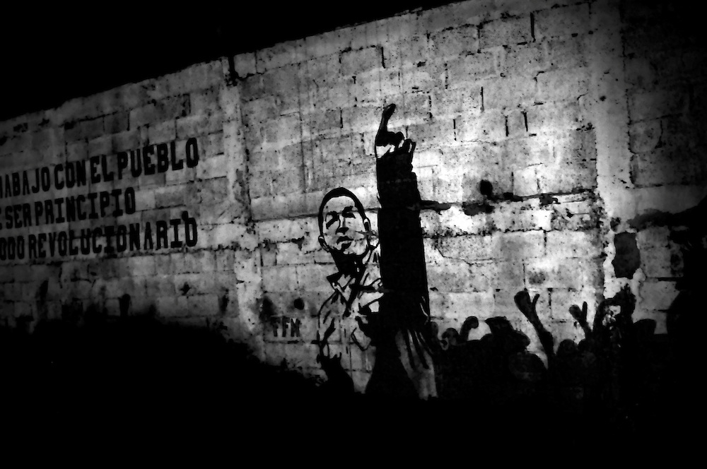 Political graffiti of President Hugo Chavez on a wall in Petare. The Petare slum is one of the most violent areas of Caracas, Venezuela, reporting over a dozen homicides every weekend. According to the ngo, the Venezuelan Observatory of Violence (OVV), Caracas has one of the highest violent crime rates in the world, with two people murdered every hour, a homicide rate that has quadrupled over the eleven year presidency of Hugo Chavez. Equally disturbing is the level of impunity, corruption and incompetency in the Venezuelan judicial system. OVV reports that 91% of crimes go unsolved in Venezuela.