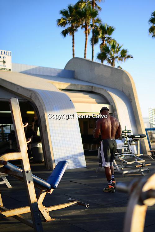 Man training at outdoors gym on Venice Beach, California.