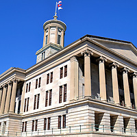 Tennessee State Capitol Building in Nashville, Tennessee<br /> The Tennessee State Capitol Building in Nashville patterns a Greek Ionic temple. On top of its limestone fa&ccedil;ade is a tower instead of a traditional dome. Before the building was finished in 1859, architect William Strickland died and was buried in a crypt above the cornerstone. He is credited with initiating the Greek Revival movement. Some people claim his ghost haunts the building. Tennessee became the 16th state on June 1, 1796.