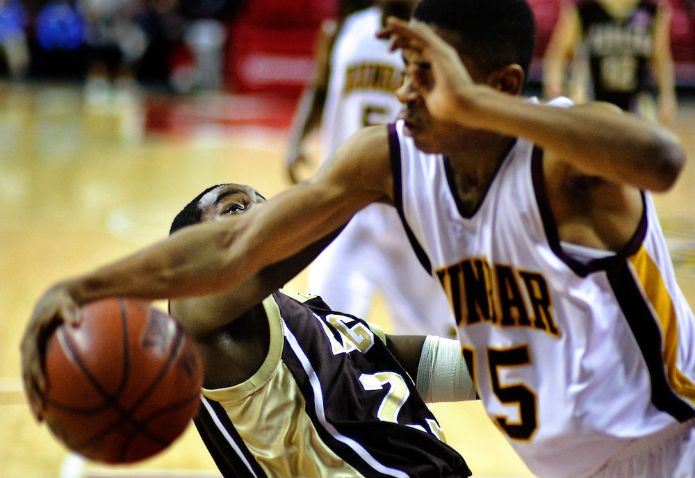 (staff photo by Matt Roth)..Owings Mills's Isaac Brown falls to the floor after a massive block by Dunbar's Jalen Jennings. Owings Mills lost to Dunbar 64-53 in the 1A state Championship game at The University of Maryland's Comcast Center Saturday, March 13, 2010.
