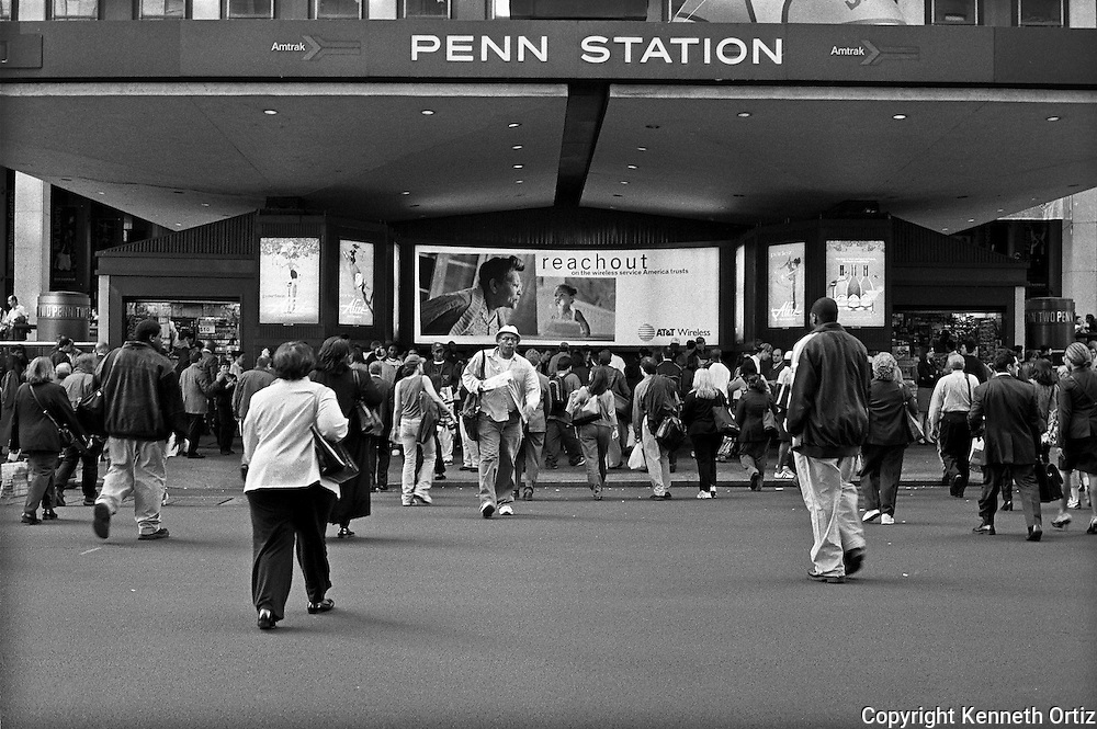 Penn Station entrance by Madison Square Garden on seventh Avenue.  Its that time of day when people start heading home.