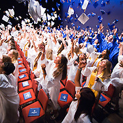 06/04/11 Wilmington DE: Charter School of Wilmington students  celebrate by tossing their caps during the final moments of Charter School of Wilmington commencement exercise Saturday, June 4, 2011, at The Grand Opera House In Wilmington Delaware..