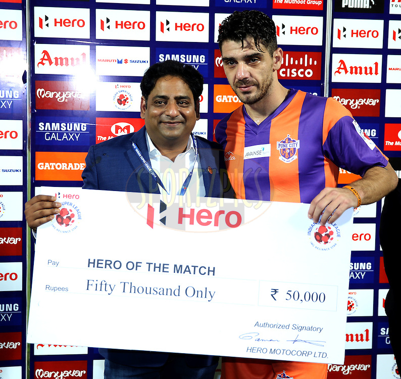 Kostas Katsouranis of FC Pune City recives Hero of the match award during the presentation of the match 44 of the Hero Indian Super League between FC Pune City and Atletico de Kolkata FC held at the Shree Shiv Chhatrapati Sports Complex Stadium, Pune, India on the 29th November 2014.<br /> <br /> Photo by:  Sandeep Shetty/ ISL/ SPORTZPICS