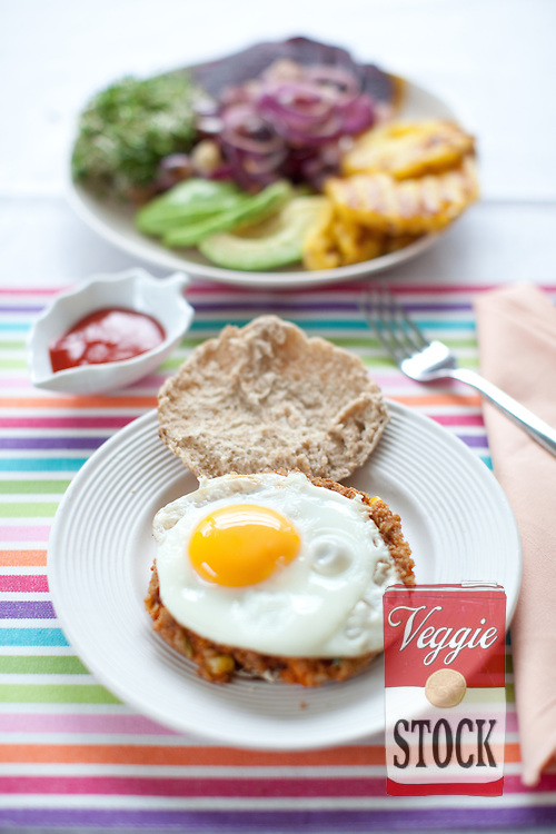 Vegetarian Aussie Burger - 4 of your favourite frozen veggie burgers?(like Good Life, Spicy Bean Quarterpounders with Chipotle Chilli)?4 free-range eggs?4 slices fresh pineapple?handful alfalfa sprouts?2 large red onions?1 avocado sliced?2 medium cooked beetroots sliced?organic low sugar tomato sauce?4 brown pita breads.Grill your burgers and pineapple slices until hot all the way through.?Cut the onions into rings and saute in a pan until soft.?Fry the eggs until they are cooked the way you like them.?Lightly toast the pita breads and cut them in half.?Lay one cooked burger on each bottom half of the bread followed by a fried egg. Layer with the remaining ingredients and put the top of the bread on.?Grab hold with both hands and enjoy!