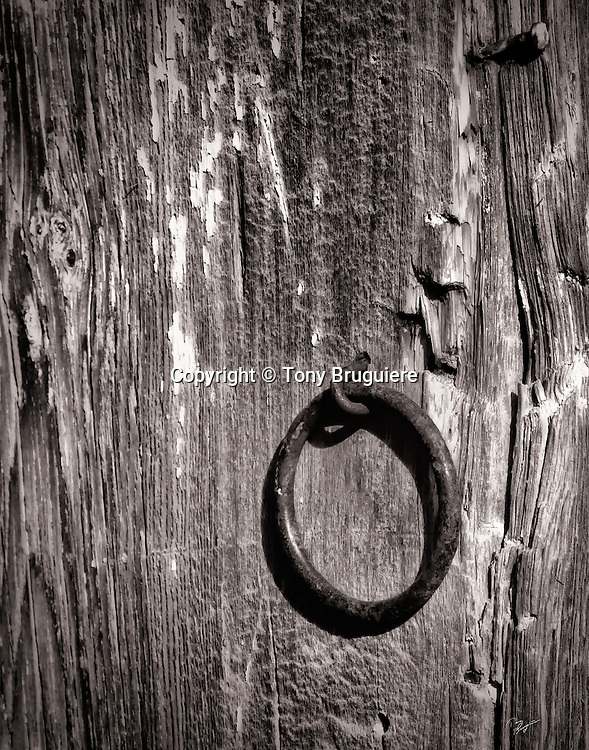 A rusted hitching ring on a weathered post is still used on this southern Colorado ranch.