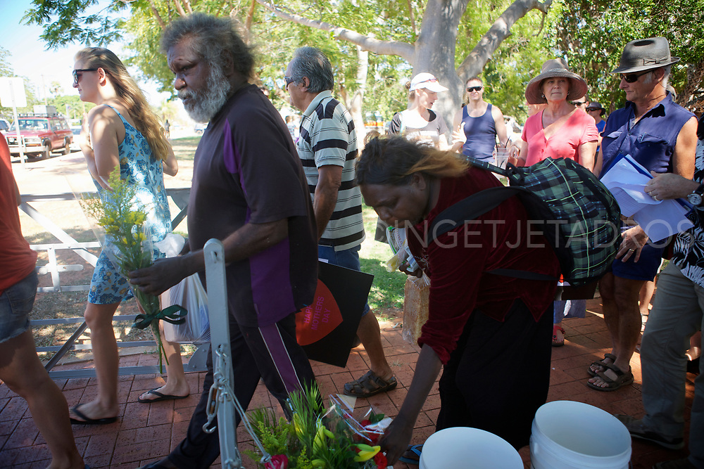 "Broome's Community is Celebrating Mothers Day at the Courthouse Markets in Broome . A silent gathering showing concerns about the numbers of police positioned in town and the proposed gas Hub at James Price Point. People offered flowers to the Police Officers inside the police station to give to their mothers. ""We are the families of Broome residents, we are not professional protesters, and we are concerned about what is coming."" Broome, WA"