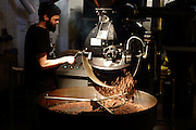 Roasting the beans at the Ozone Coffee Roasters in Leonard Street, Shoreditch, East London