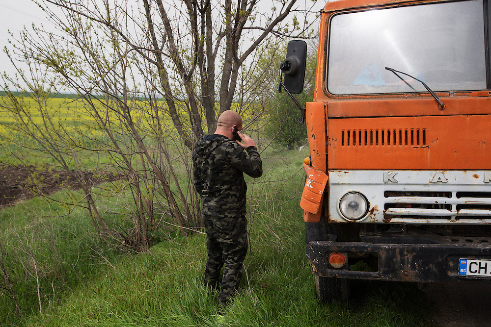 Dinko Valev on his cell phone after his dump truck broke down on the road near his junkyard in Yambol, Bulgaria.<br /> <br /> Matt Lutton / Boreal Collective for VICE
