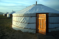 Traditional ger or yurts consist of a circular wooden frame carrying a felt cover. The felt is made from the wool of the flocks of sheep that accompany most nomads. The timber to make the external structure is notfound on the treeless steppes so must be bought or traded for in the towns or village.<br /> The frame consists of lattice wall sections, a door frame, roof poles and a crown. Some ger have columns to support the crown. The self supporting wood frame is covered with pieces of felt which is then covered with canvas for waterproofing and windproofing.