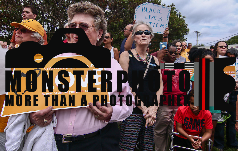 "Members of the First Unitarian Church congregation hold  signs that reads ""Standing On The Side Of Love"" during a rededication ceremony Sunday, August 21, 2016, at First Unitarian Church in Wilmington."