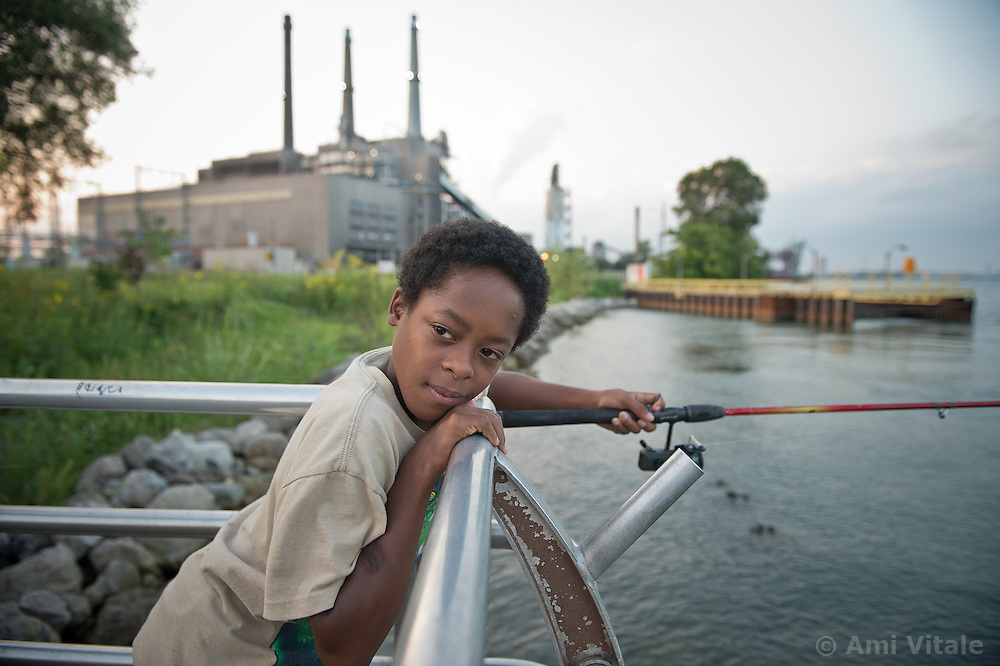Jordan Beverly, 12 in a park next to a coal plant in River Rouge, Detroit,  August 15, 2012.  They all suffer from Asthma.