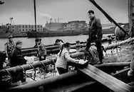 Unloading crabs on a canal side fish market opposite Baoshan Steel, Shanghai, China.  China's industry sector is often uncomfortably close to the source and processing of food.