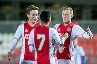AMSTERDAM - Jong Ajax - FC Eindhoven , Voetbal , Jupiler league , Seizoen 2016/2017 , Sportpark de Toekomst , 24-02-2017 , Jong Ajax speler Kaj Sierhuis (r) viert zijn goal voor de 1-0 met man van de assist Jong Ajax speler Justin Kluivert  (m)