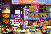 Neon signs and traffic, Tsim Sha Shui, Hong Kong, China..