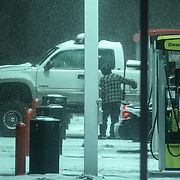 A man fills his truck with gas at a Wawa gas station as snow falls Friday, Jan, 22, 2016 in Newark.<br /> <br /> A massive blizzard dumps snow in Newark, and eastern United States on Friday, with mass flight cancellations, five states declaring states of emergency.