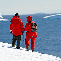 An elder couple enjoy Antarctica´s vast inmensity from Portal Point in Antarctica.Model Released photo.