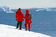 An elder couple enjoy Antarctica´s vast inmensity from Portal Point in Antarctica.Model Released photo.