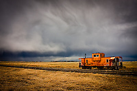 A vintage caboose sits on its tracks with the dramatic clouds of a brewing storm behind it.<br /> <br /> <br /> <br /> &copy;2009, Sean Phillips<br /> http://www.Sean-Phillips.com