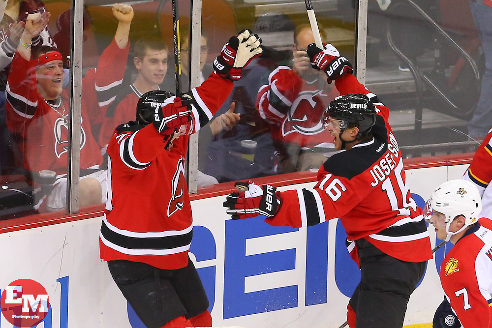 Mar 31, 2014; Newark, NJ, USA; New Jersey Devils center Ryan Carter (20) and New Jersey Devils center Jacob Josefson (16) celebrate Josefson's goal during the third period at Prudential Center. The Devils defeated the Panthers 6-3.