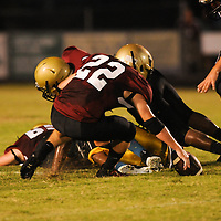 Ashley High School's Parker Greenough recovers a fumble against Fairmont High School Friday September 5, 2014 in Wilmington, N.C. (Jason A. Frizzelle)
