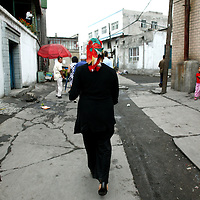URUMQI, JULY-15 : &quot; They threw a shirt over his head and led him away without saying a word,&quot; said his wife, Resuangul while walking in an alley in Urumqi's Xiangyang Po district, a poor quarter of the city dominated by Uighurs, Turkic-speaking Muslims who have often had an uneasy relationship with China's Han majority. Uighurs are the largest ethnic group in Xinjiang, but in Urumqi, Han make up more than 70 percent of the 2.3 million residents.<br /> Many Han Chinese were killed in Xiangyang Po during the protests in early July 2009.